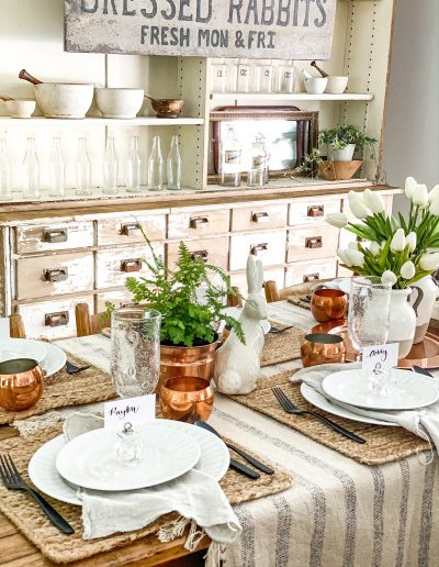 Table setting with rabbit sign on hutch