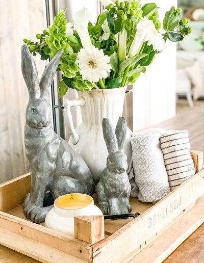 Flower bouquet in white ironstone vase in crate on kitchen island