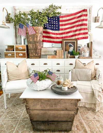 Music room with large vintage American flag and sea captain painting