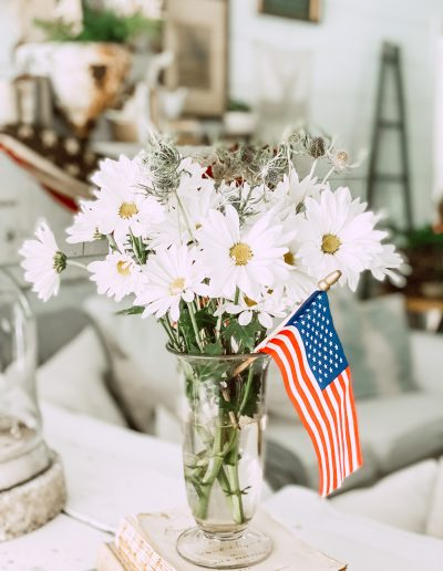 Bouguet of white daisies with small american flag