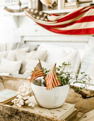Patriotic coffee table decorations with vintage flat in background