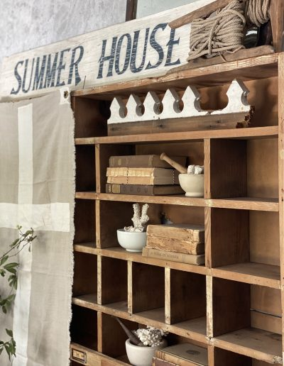 Summer Entryway cubby with mortar & pestles and old books