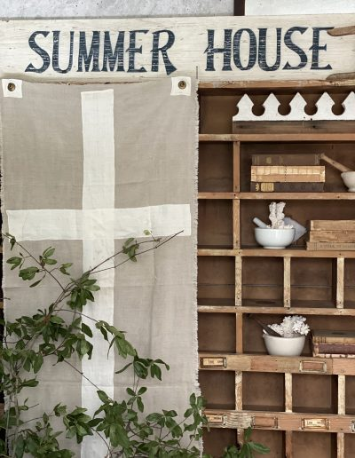 Entry way with canvas white cross & summer house sign